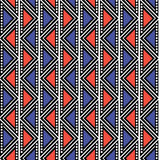 Seamless  geometric pattern. Blue and red background with triangles in the shape of zigzag. Royalty Free Stock Images