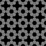 Seamless geometric pattern of circles on a black background. Stock Photography