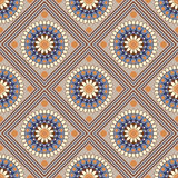 Seamless geometric pattern, colored mandala with rhombus on beig Stock Images