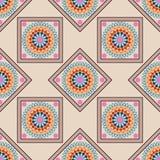 Seamless geometric pattern, colored mandala with rhombus on beig Stock Photos