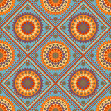 Seamless geometric pattern, colored mandala with rhombus on a bl Stock Photography