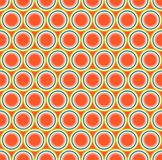 Seamless geometric pattern. Elements of round shape, located on a bright orange background. Stock Photos