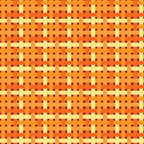 Seamless geometric pattern. Patchwork texture in warm, bright, orange  colors. Geometric pattern weaving. Stock Image
