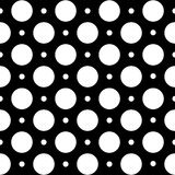 Seamless geometric pattern in polka dots on a black background. Royalty Free Stock Photos