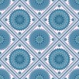 Seamless geometric pattern, rhombus with light blue mandala Stock Photos