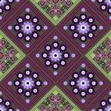 Seamless geometric pattern, a rhombus pattern with beautiful flowers Stock Images