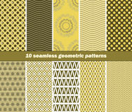 10 seamless geometric patterns in olive green and yellow colors. Set of 10 different seamless geometric patterns. Dark olive green and yellow colors. Vector Royalty Free Stock Images