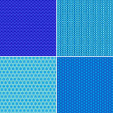 Seamless geometric patterns set. Seamless abstract geometric patterns set in blue Royalty Free Stock Photos