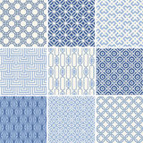 Seamless geometric patterns set. Seamless oriental geometric patterns set in blue Royalty Free Stock Photo