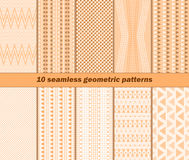 10 seamless geometric patterns in warm autumn colors. Set of 10 different seamless abstract geometric patterns in warm autumn colors. Vector illustration for Stock Image