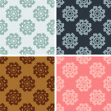 Seamless geometrical flowers pattern set. Seamless colored geometrical flowers pattern set Stock Photography