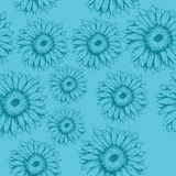 Seamless gerbera flowers pattern on the blue background Stock Photos