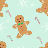 Seamless gingerbread candycane and snowflakes Stock Photos