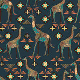 Seamless giraffe pattern made from flowers, leaves in the bohemian style. Animal print. Stock Image