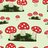 Seamless glades of fly agarics Stock Image