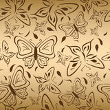 Seamless gold backgroгnd with butterflies Stock Image