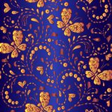 Seamless gold floral pattern on a blue background. Decorative ornament backdrop for fabric, textile, wrapping paper Stock Photography