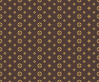 Seamless golden pattern on brown background.  Stock Image