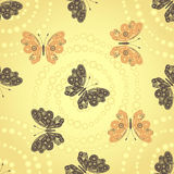 Seamless golden pattern with brown and beige butterflies Stock Photo