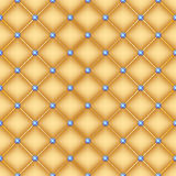 Seamless golden quilted background with pins. Stock Photo