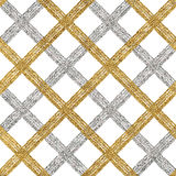 Seamless golden silver background of diagonal stripes, lines or strokes Stock Images