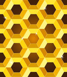 Seamless golden yellow honeycomb pattern. Seamless pattern of luxurious golden yellow honeycombs with sparkles over dark brown gradient background Royalty Free Stock Photo