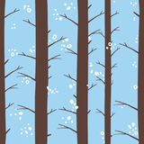 Seamless graphical stylized colored winter forest pattern texture element. At morning Stock Photography