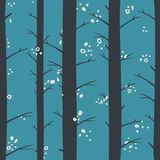 Seamless graphical stylized colored winter forest pattern texture element. In the evening Royalty Free Stock Image
