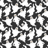 Seamless gray pattern with cute ghosts Stock Images