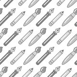 Seamless grayscale pattern with pens, brushes and pencils Royalty Free Stock Photography