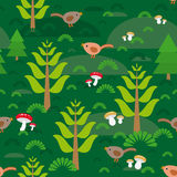 Seamless green background with fir trees mushrooms birds.  Royalty Free Stock Images