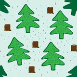 Seamless green background with fir trees Stock Photos