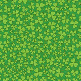 Seamless Green on Green Shamrocks. A seamless pattern of green shamrocks on top of a darker green background Royalty Free Stock Photo