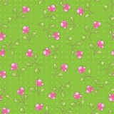 Seamless green pattern. With pink flowers Royalty Free Stock Photography