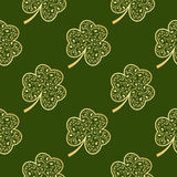 Seamless green shamrocks. Seamless pattern made from green shamrocks isolated on white background. Vector illustration Stock Photo