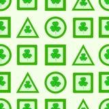 Seamless green signs of shamrocks Stock Photo
