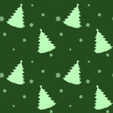 A seamless green template for christmas with pine trees Stock Photography