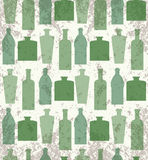 Seamless grunge pattern with a transparent bottle Royalty Free Stock Image