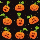 Seamless Halloween background. With cute pumpkins on black background Royalty Free Stock Image