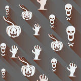 Seamless Halloween background. Pumpkin, skull and contorted hands with Long shadows on a gray backdrop. Stock Image