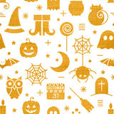 Seamless Halloween gold textured pattern. With festive Halloween icons. Golden design for wrapping paper, paper packaging, textiles, holiday party invitations Royalty Free Stock Photo