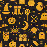 Seamless Halloween gold textured pattern. With festive Halloween icons. Golden design for wrapping paper, paper packaging, textiles, holiday party invitations Stock Photo