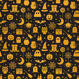 Seamless Halloween gold textured pattern. With festive Halloween icons. Golden design for wrapping paper, paper packaging, textiles, holiday party invitations Stock Images