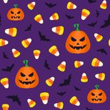 Seamless Halloween pattern with candy corns and pumpkins. Vector illustration Stock Photography