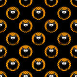 Seamless halloween pattern with cartoon owls in hollows over bla Stock Image