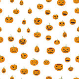 Seamless halloween pattern with carved pumpkinst. Jack-o-lantern. Vector illustration, isolated on white background. Stock Images