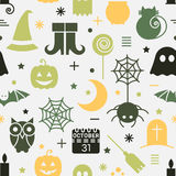 Seamless Halloween pattern. Seamless Halloween colorful pattern with festive Halloween icons. Design for wrapping paper, paper packaging, textiles, fabric Royalty Free Stock Images