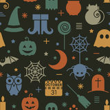 Seamless Halloween pattern. Seamless Halloween colorful pattern with festive Halloween icons. Design for wrapping paper, paper packaging, textiles, fabric Royalty Free Stock Image