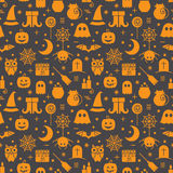 Seamless Halloween pattern. Seamless Halloween colourful orange and black pattern with festive Halloween icons. Design for wrapping paper, paper packaging Stock Photo