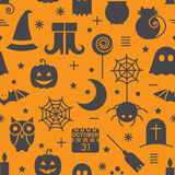 Seamless Halloween pattern. Seamless Halloween colourful orange and black pattern with festive Halloween icons. Design for wrapping paper, paper packaging Royalty Free Stock Photos